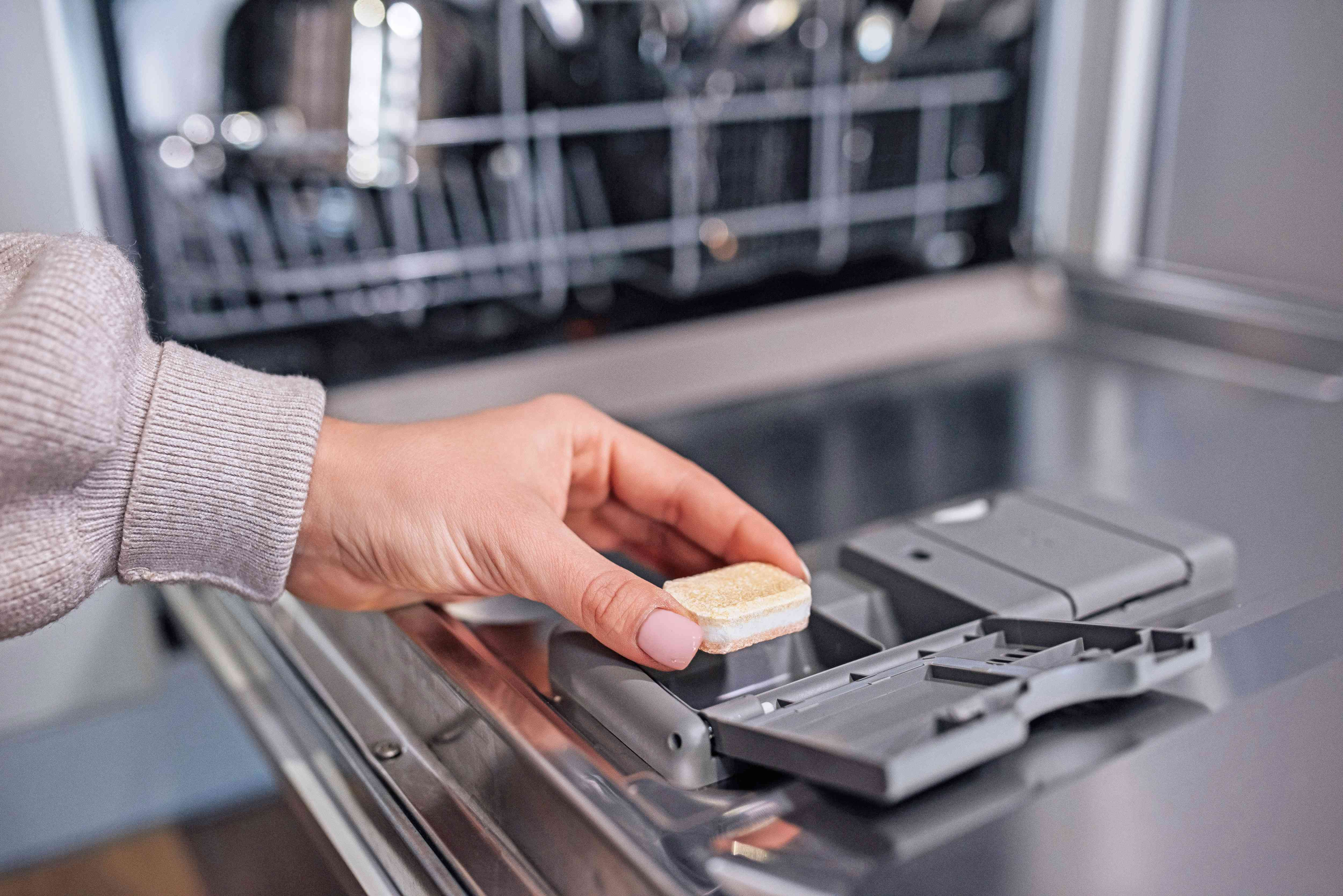 placing detergent in the dishwasher