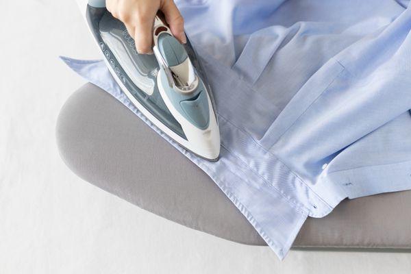 Someone ironing a shirt