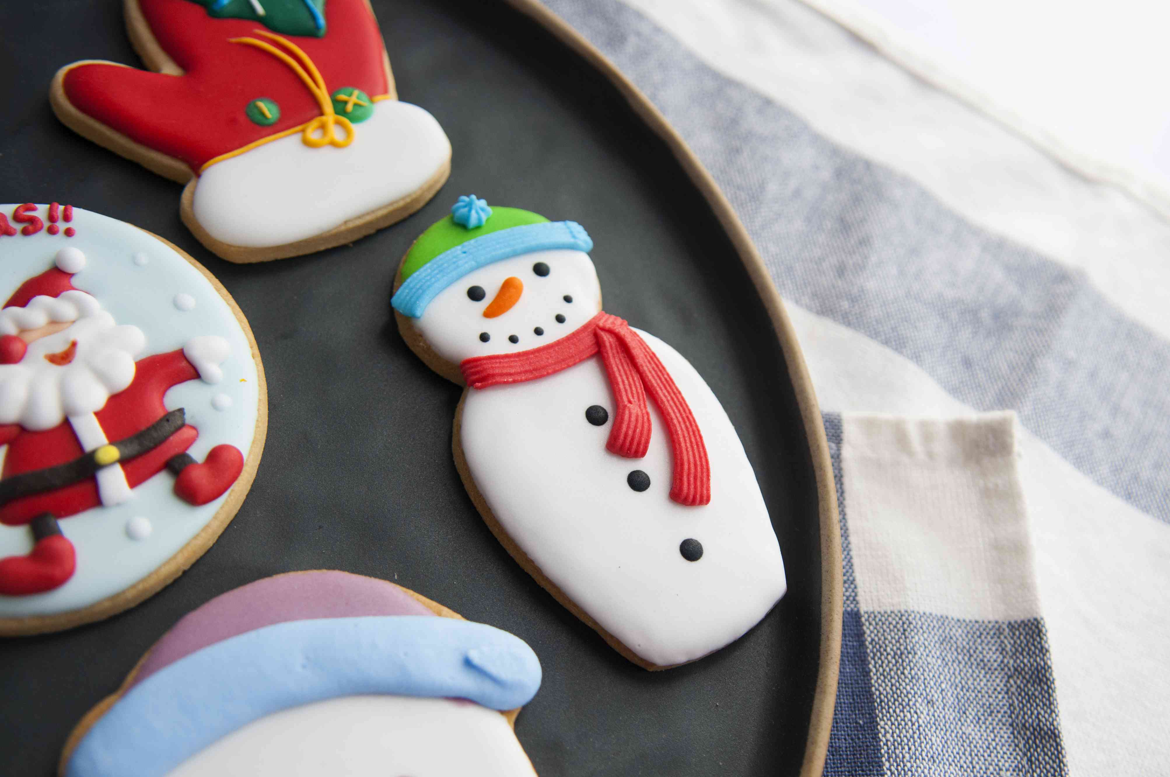 Multi Colored Gingerbread Cookies During Christmas In Plate