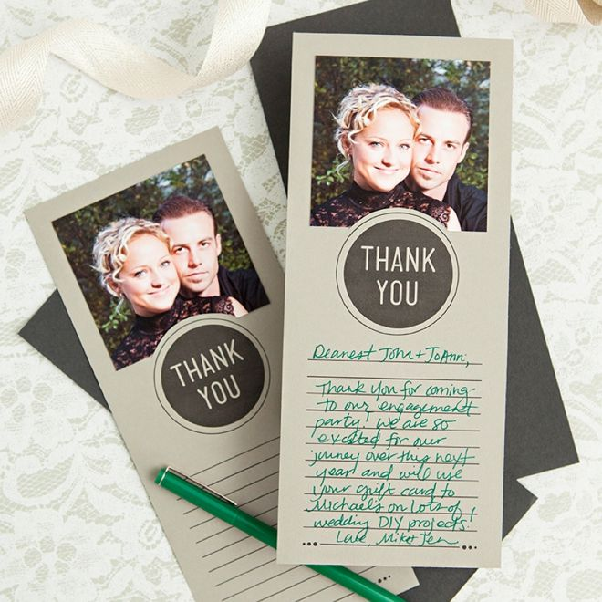 Photo cards laying on a table with a pen and ribbon