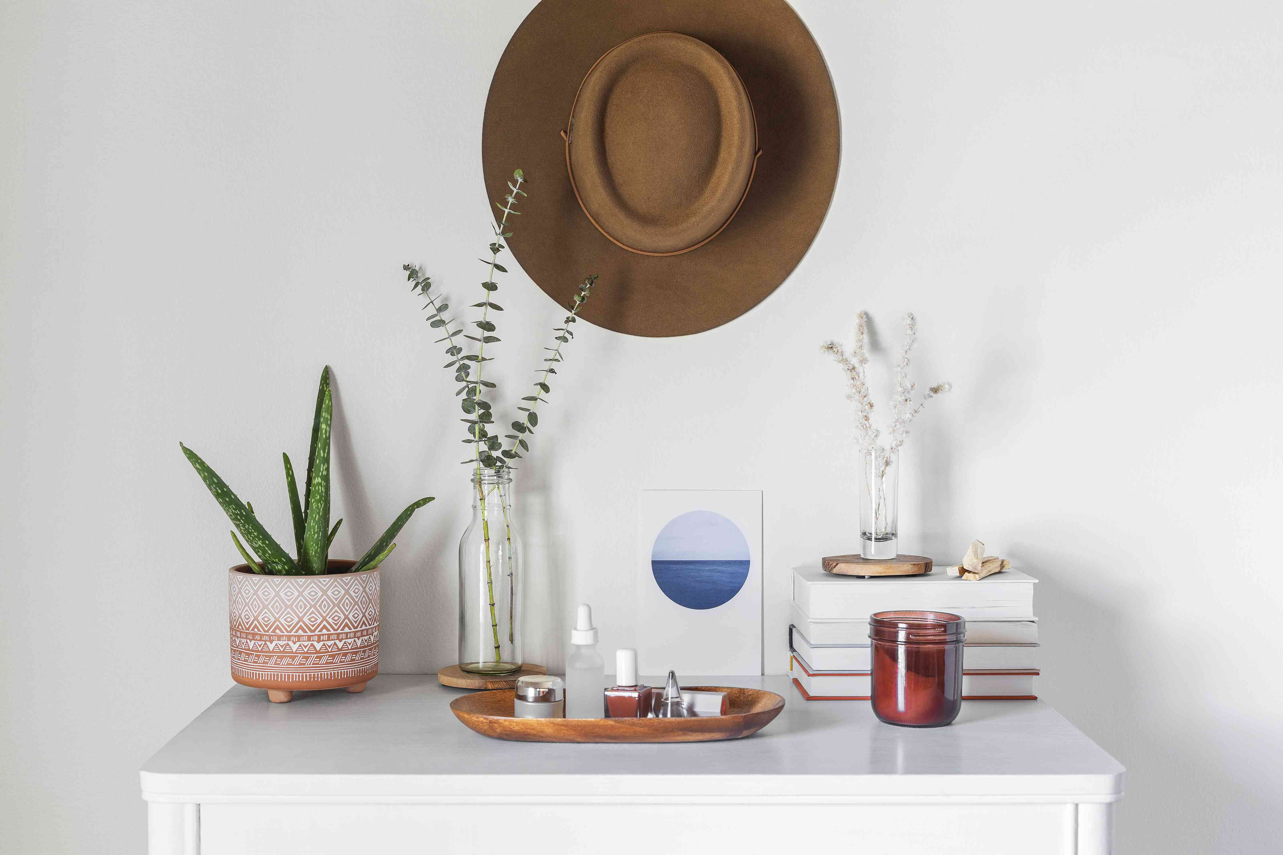 hat used as a large hanging object centered over the dresser
