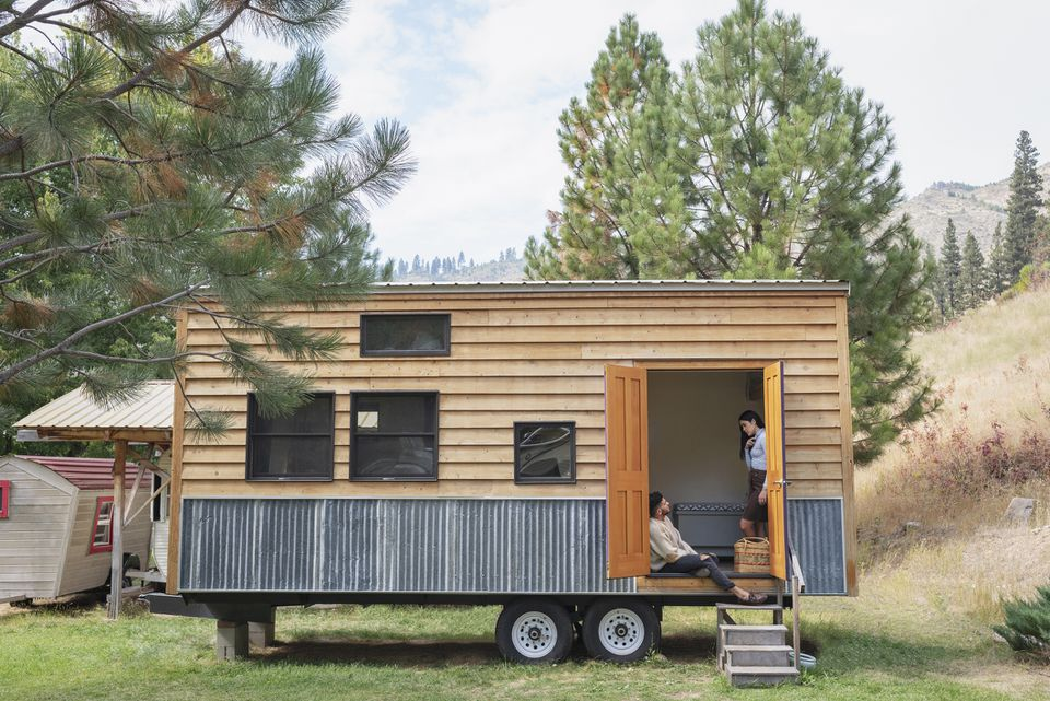 Couple in doorway of tiny house