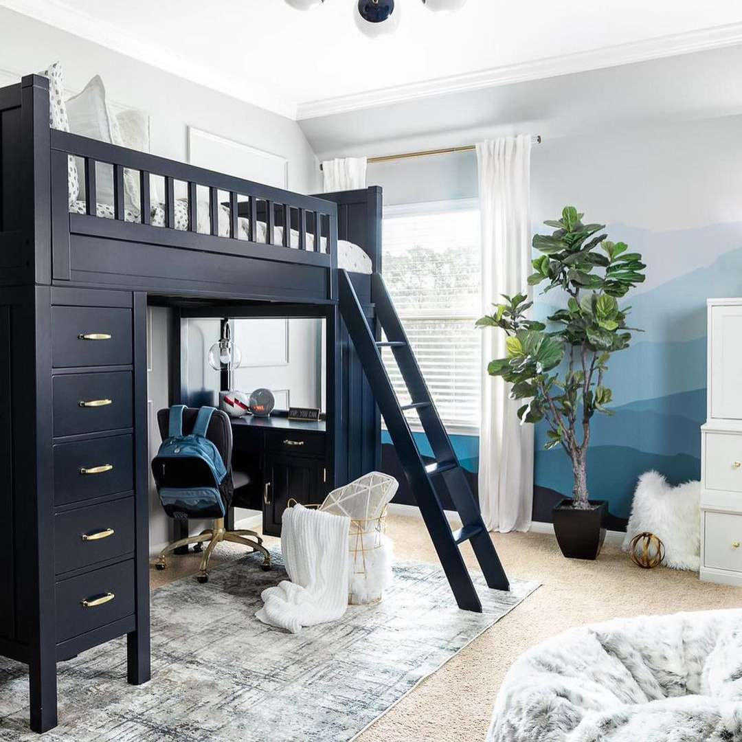 A navy blue loft bed in a kid's room with a homework station at the bottom and drawers on one side.