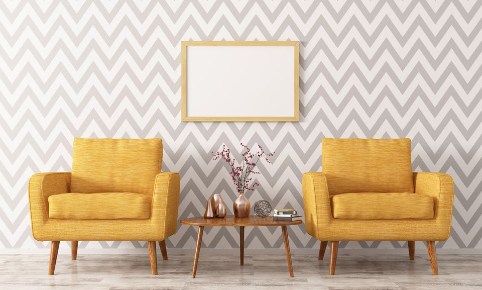 living area with gray and white wallpaper and yellow chairs