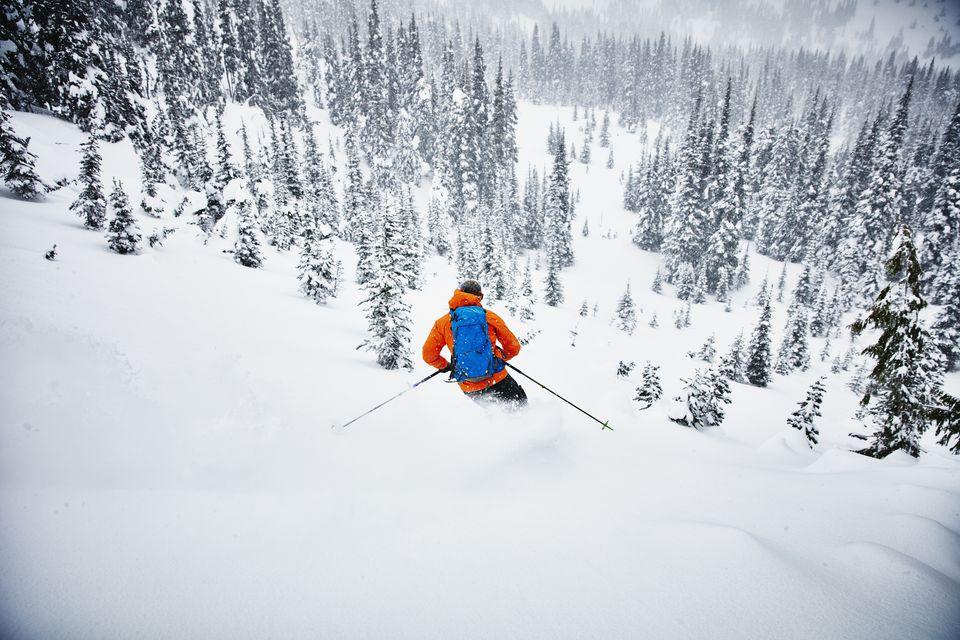 Man skiing down a snowy mountain