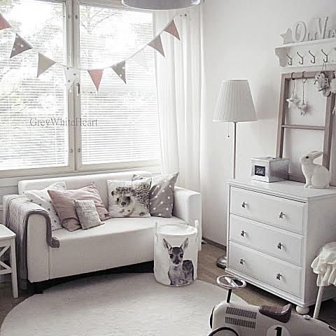 Soft and simple nursery in shades of gray.