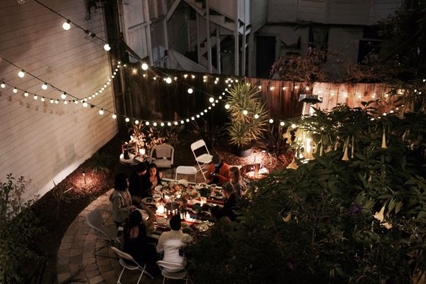 Outdoor party at night with string lights