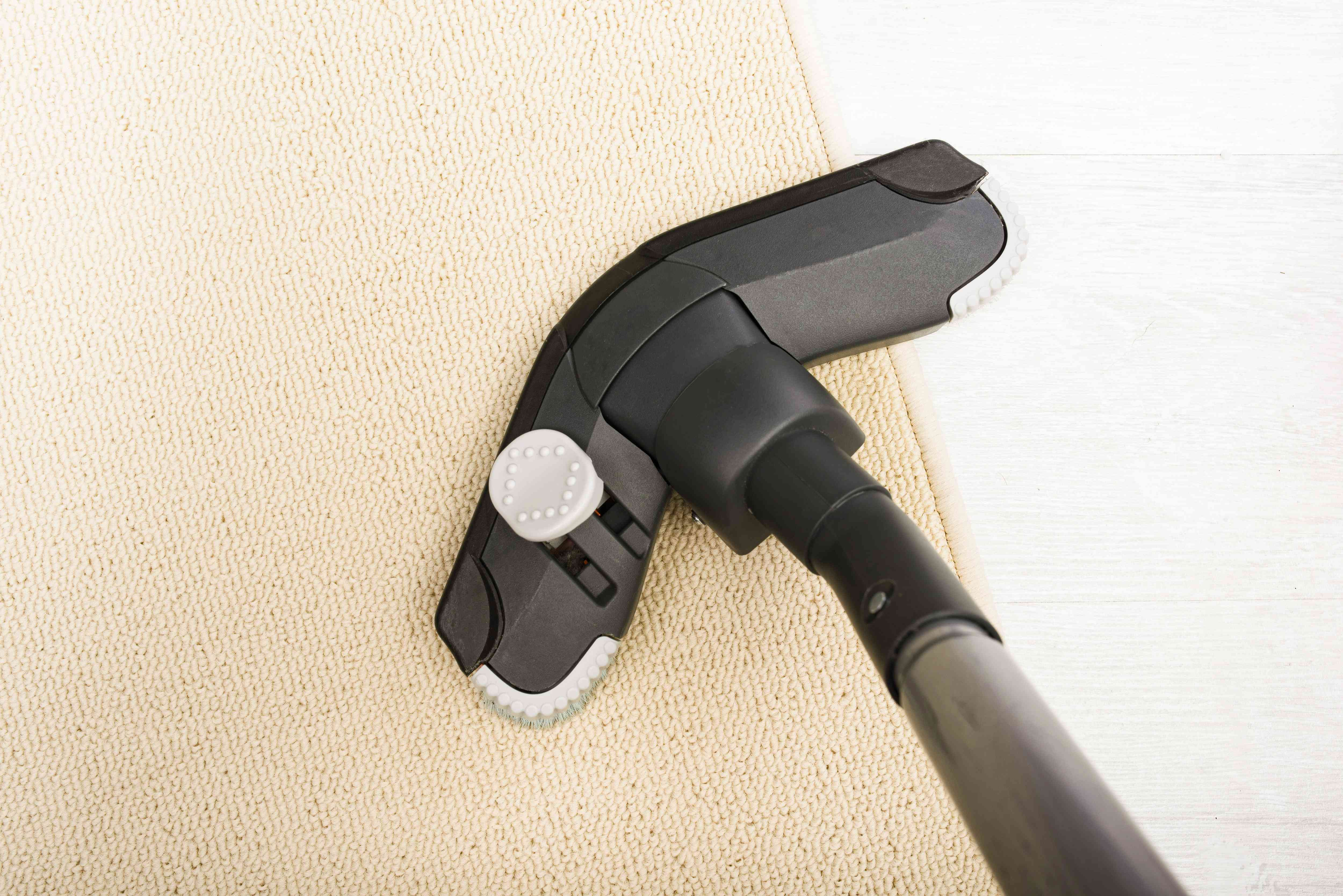 vacuuming the rug post stain removal