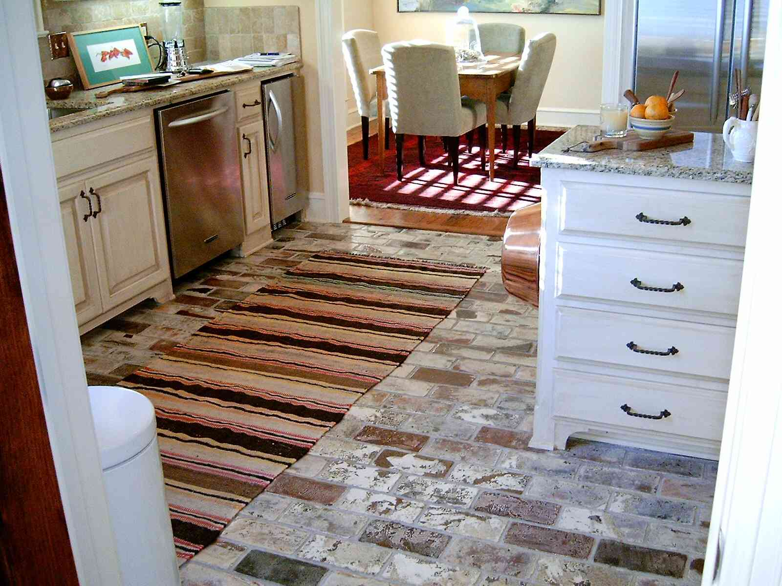 4 Inexpensive Options for Kitchen Flooring Options on kitchens with barn wood flooring, kitchens with travertine tile, kitchens with terracotta tile flooring, kitchens with white porcelain tile, kitchens with mosaic tile, kitchens with distressed wood flooring, kitchens with carpet tile flooring, kitchens with penny tile, kitchens with ceramic tile, kitchens with wood grain tile, kitchens with porcelain wood tile,