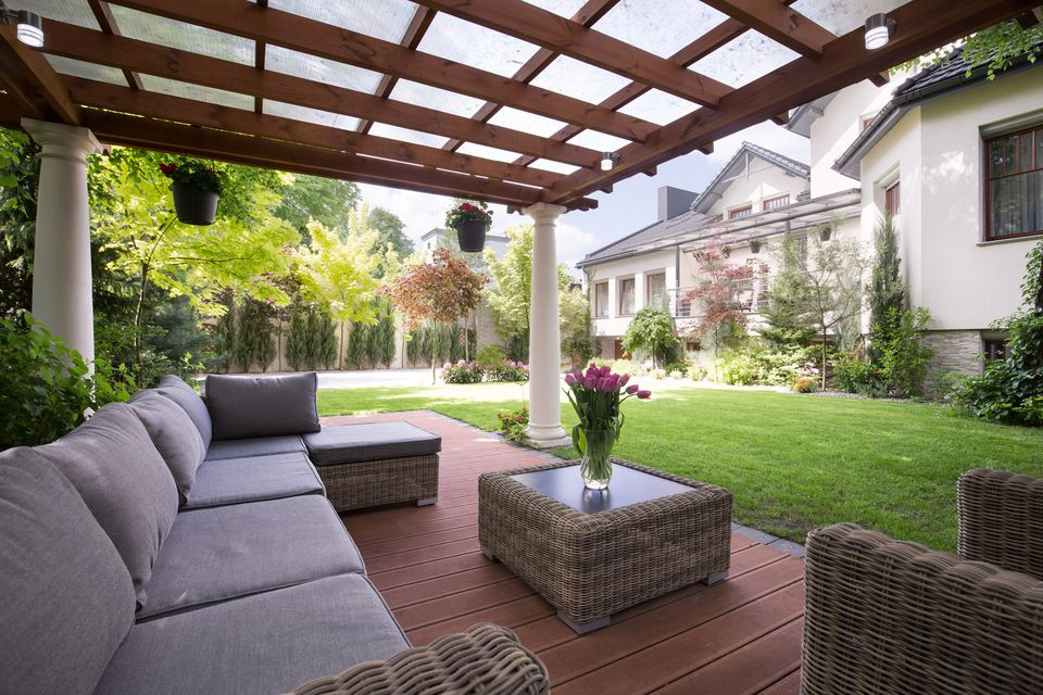 Covered pergola with furniture.