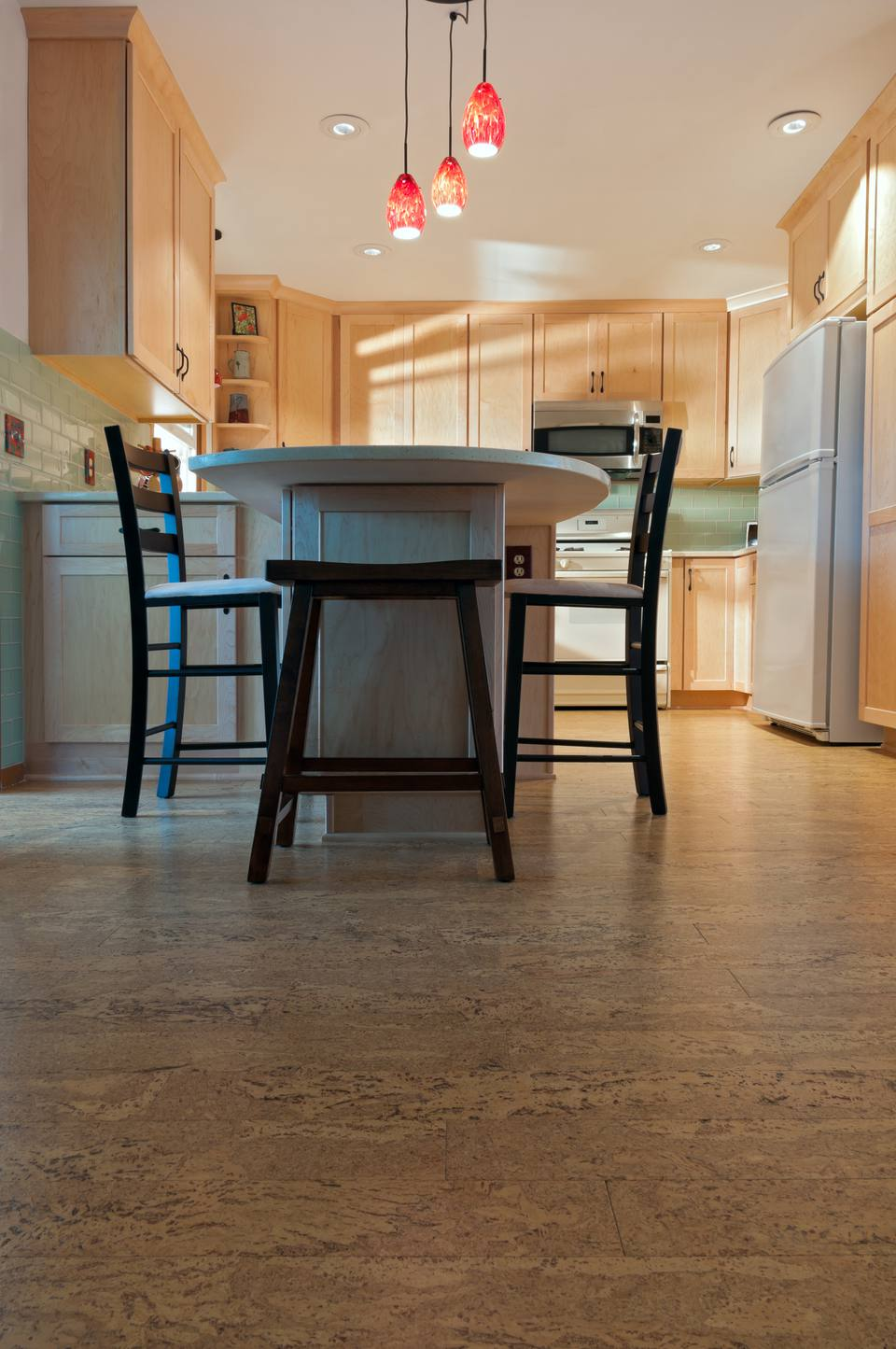 Eat In Kitchen With Light Wood Cabinets And Cork Flooring