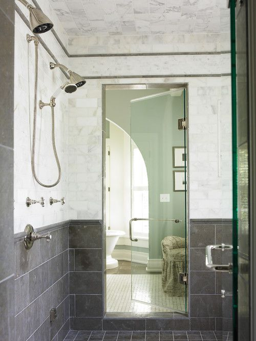 A double shower with gray tile