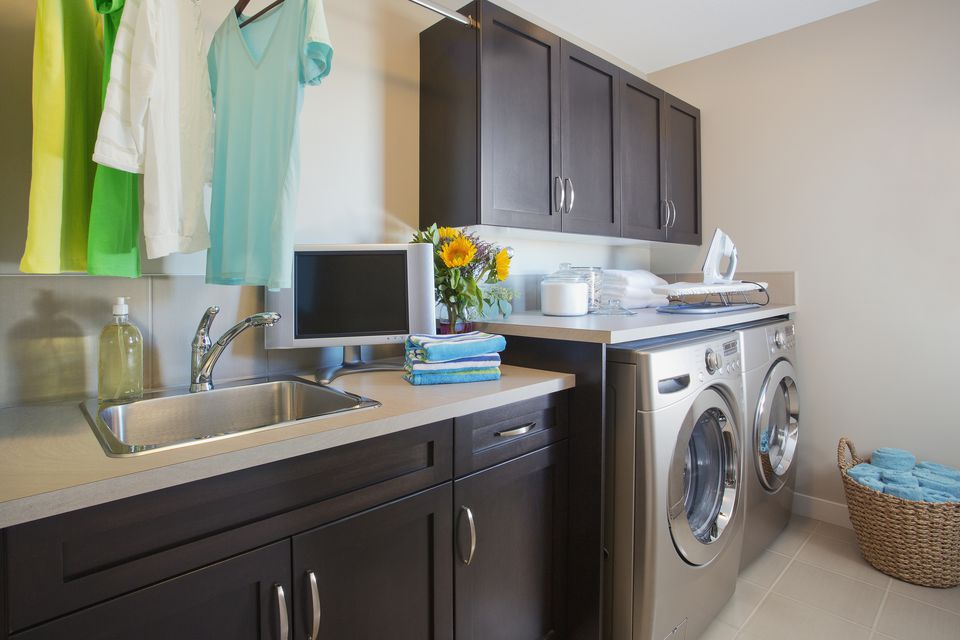 Modern laundry room with washer and dryer.