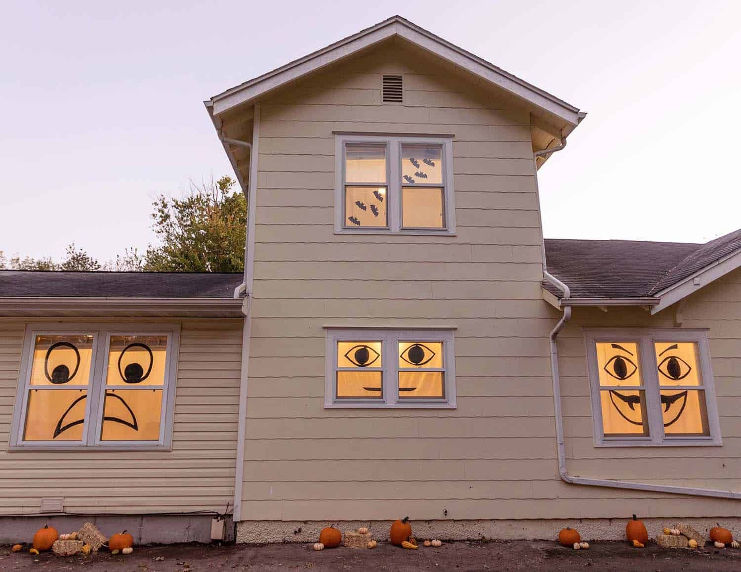 A house with black silhouettes in the window