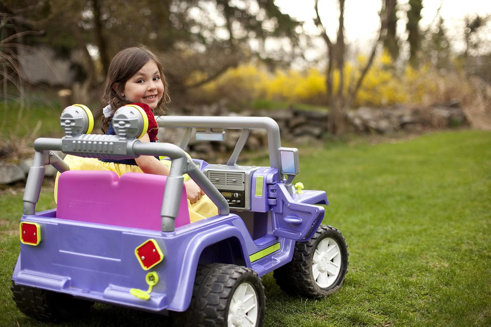 kid in toy car