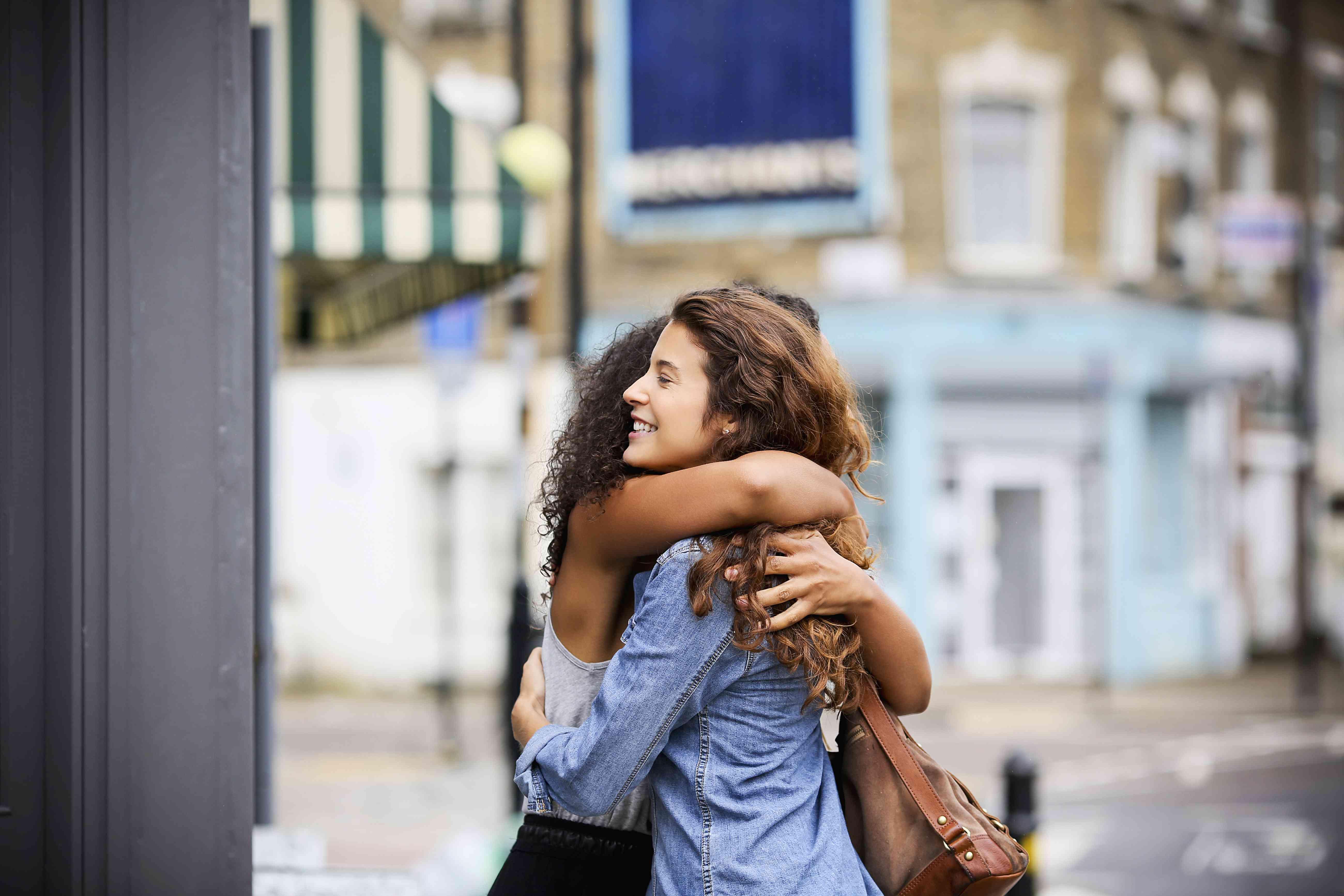 Two Women Hugging Outside