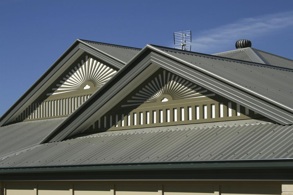 House roof with standing seam metal panels