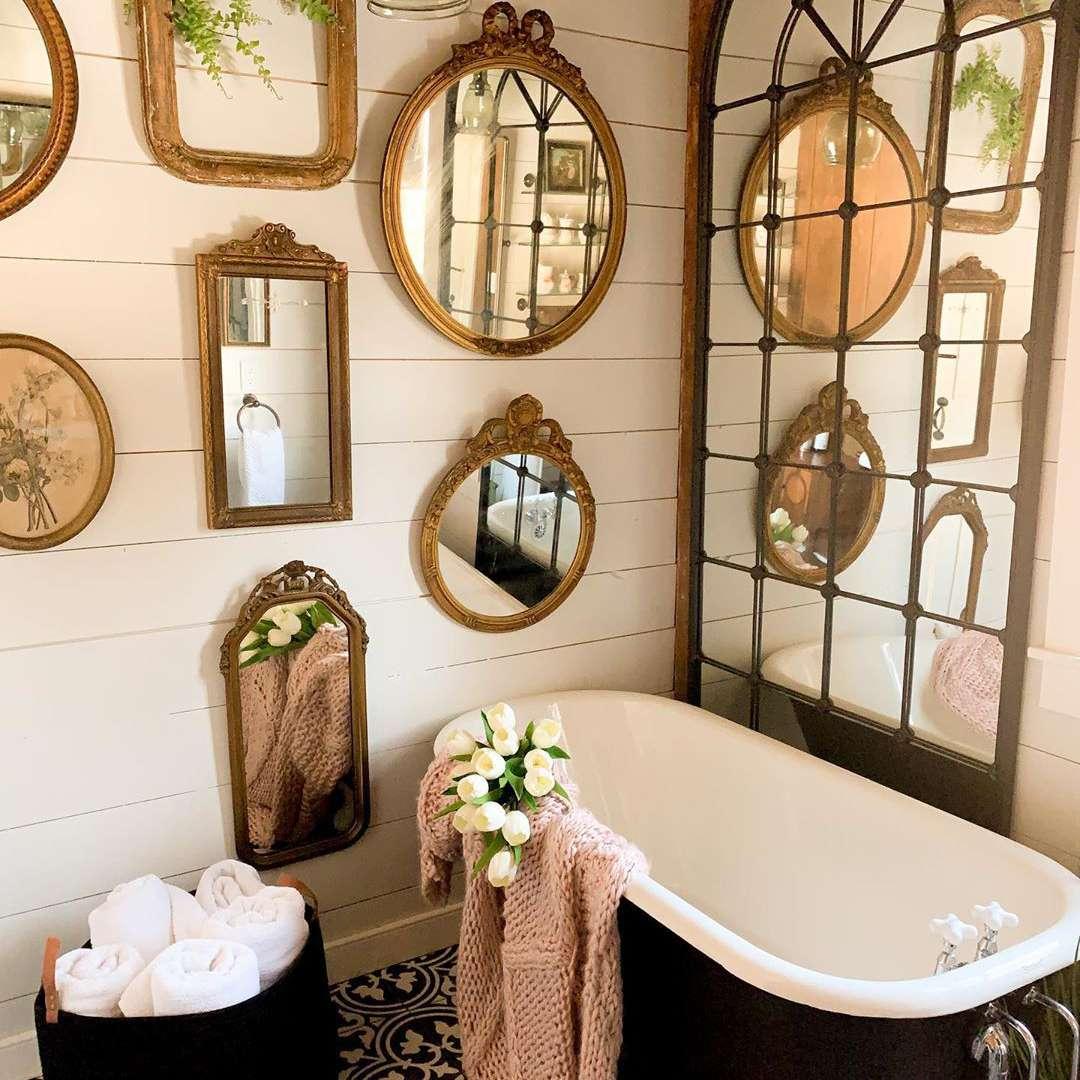 rustic bathroom with lots of vintage mirrrors