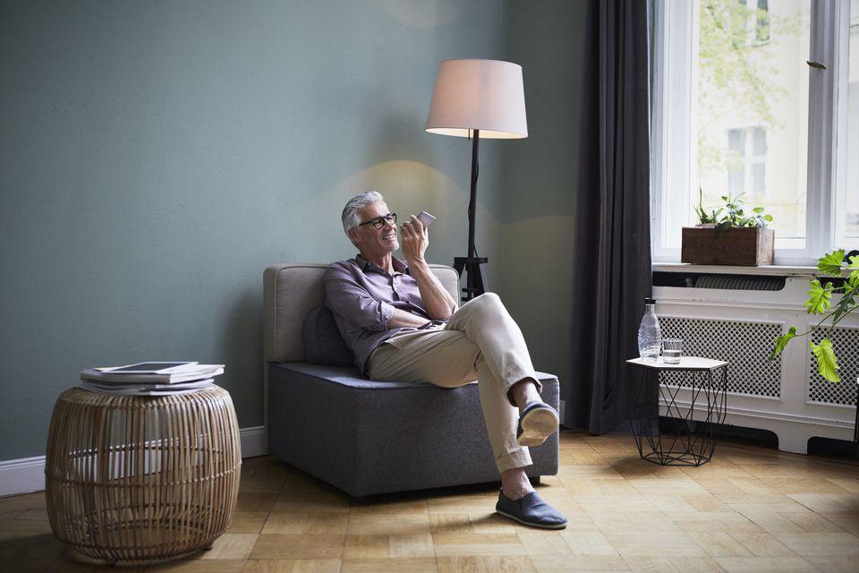 man talking on phone, lamp