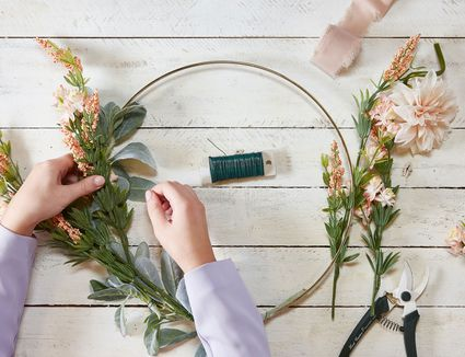 Person making floral wreath