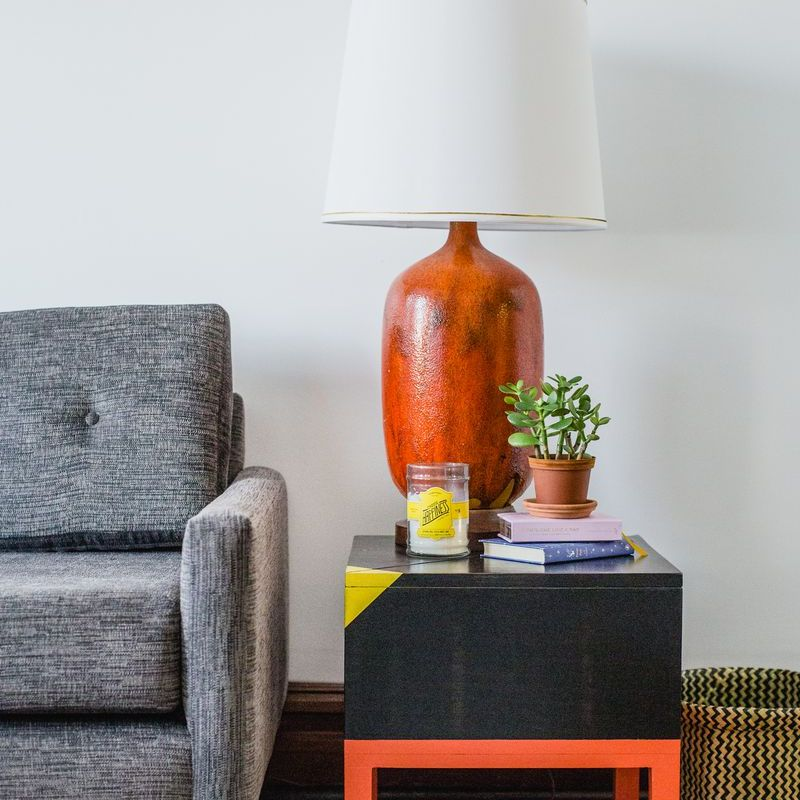A colorful cube end table in a living room