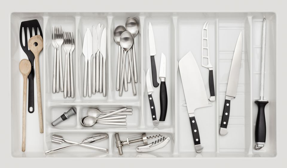 Kitchen drawer full of stainless steel utensils