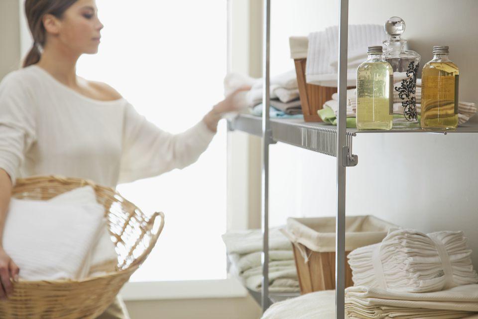 Woman using closet shelf
