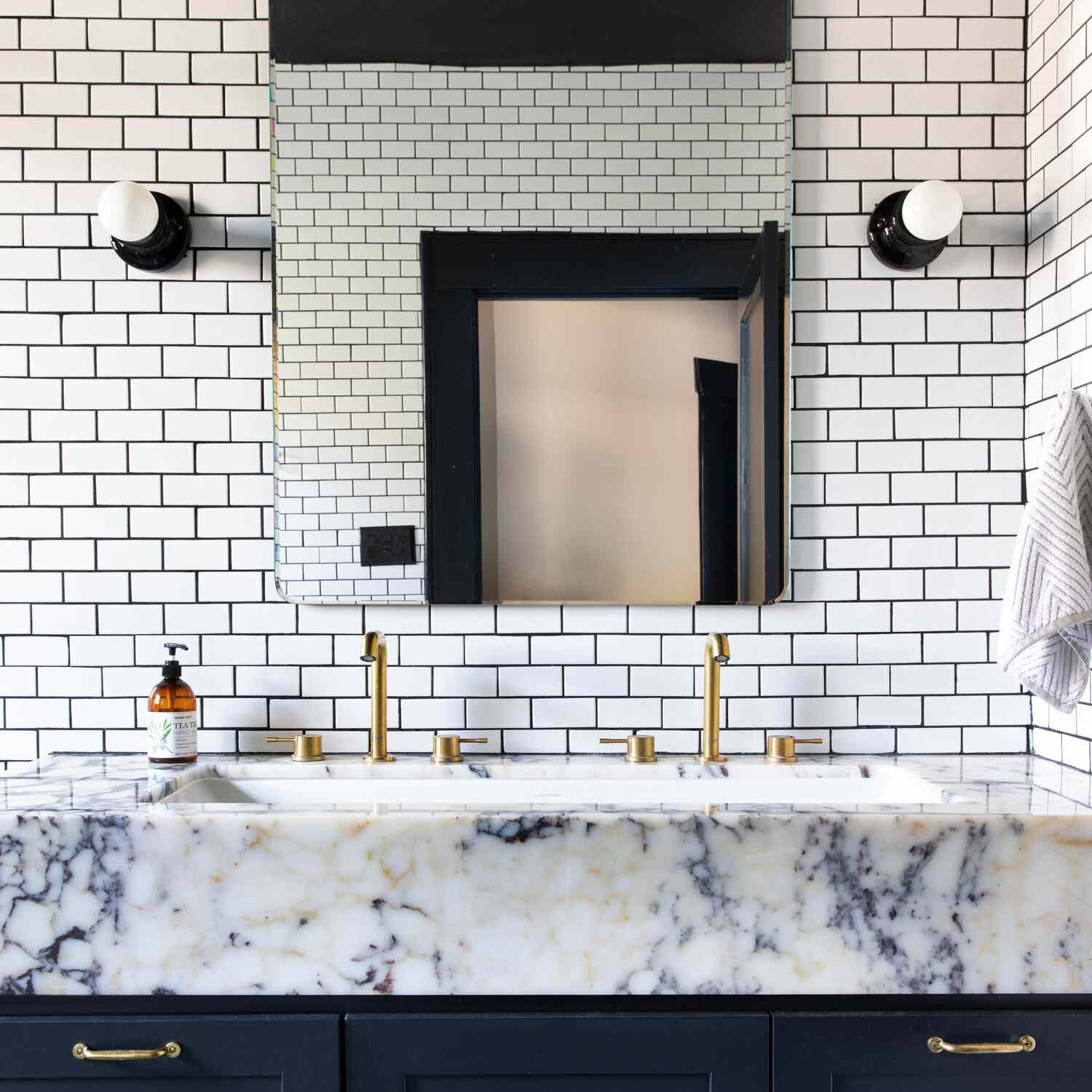 Blue, white, and yellow bathroom vanity with subway tile wall