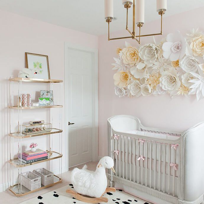 Blush pink and white swan nursery with paper flower accent wall