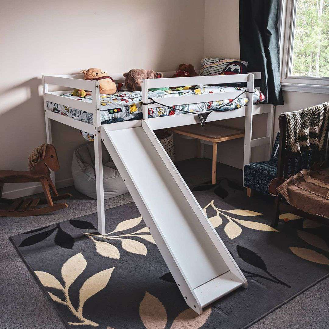 A kid's loft bed with a slide