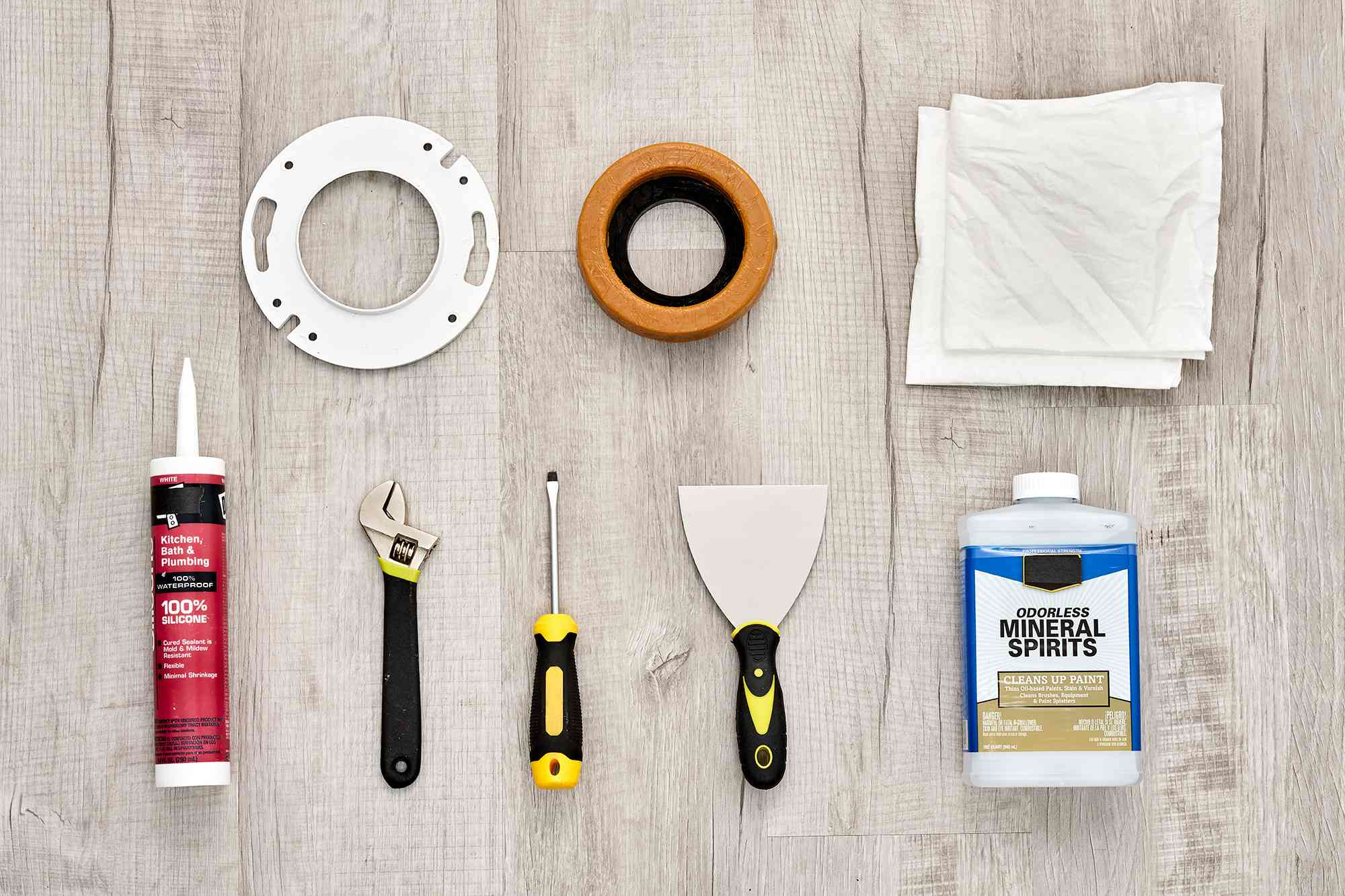 Materials and tools to install a toilet flange extender