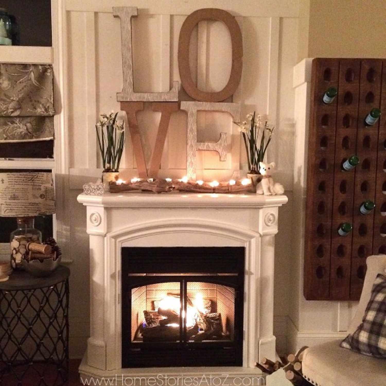 DIY tea light log above a fireplace