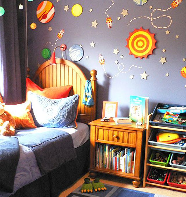 Space-themed kid's room with 3d mural