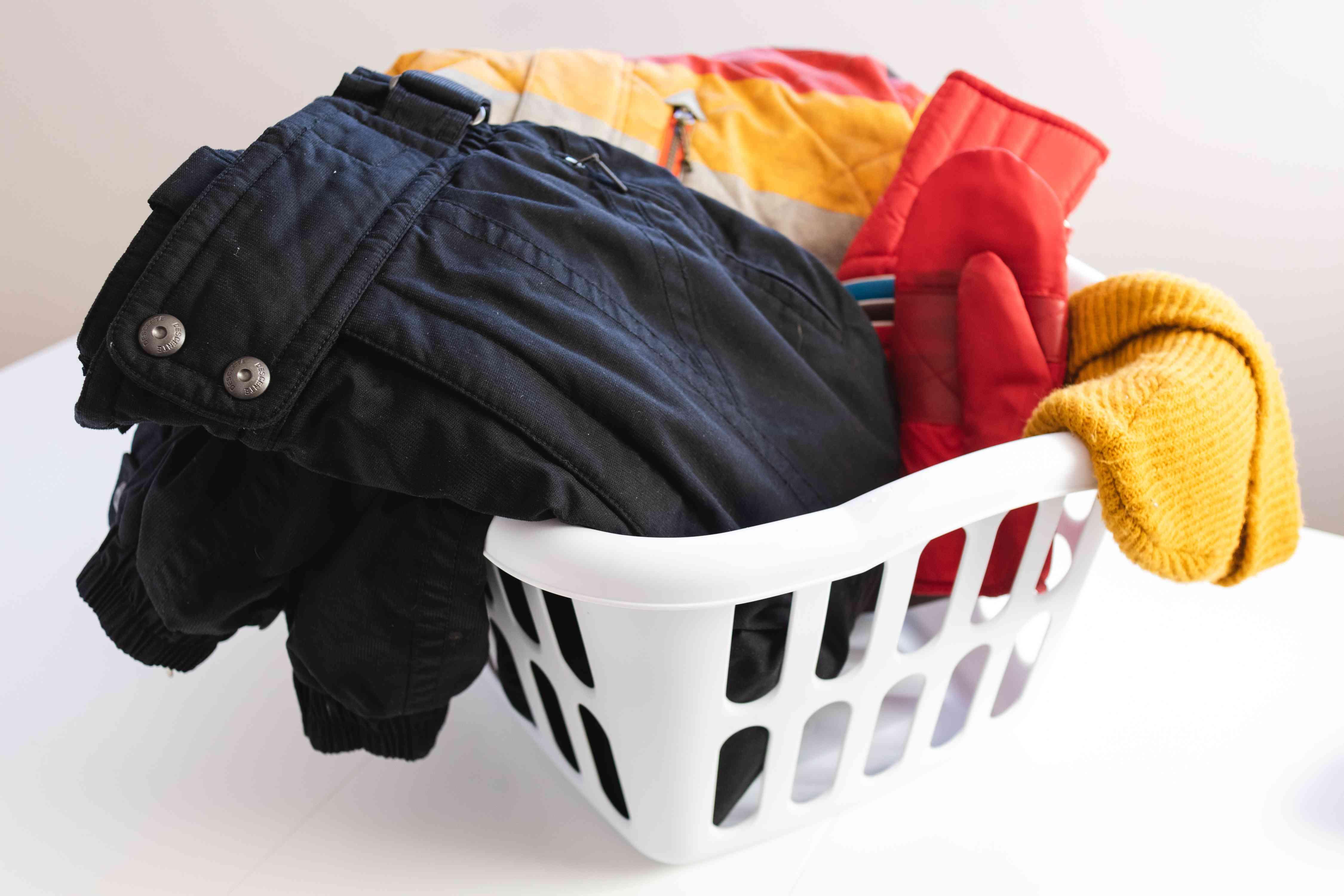 A laundry basket full of ski gear