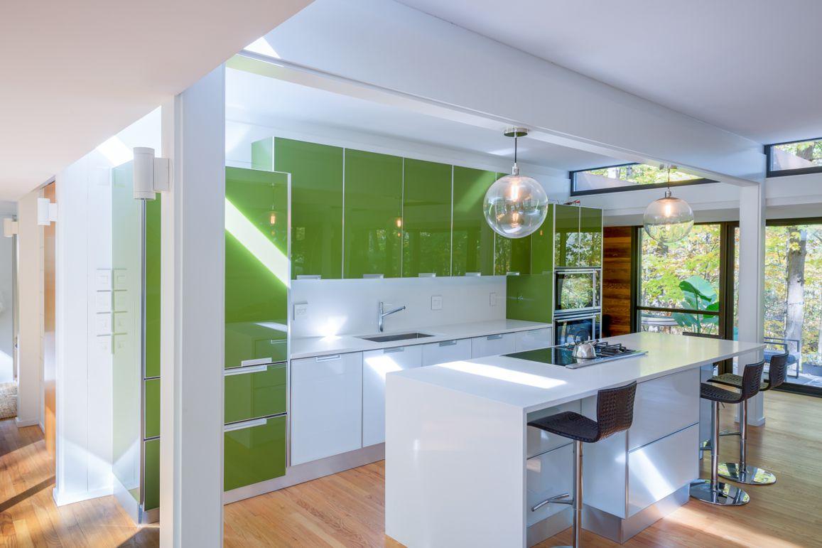 sleek green kitchen cabinets