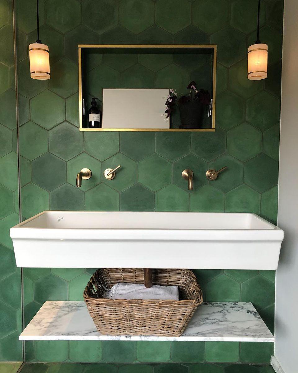 Bathroom with green tiles