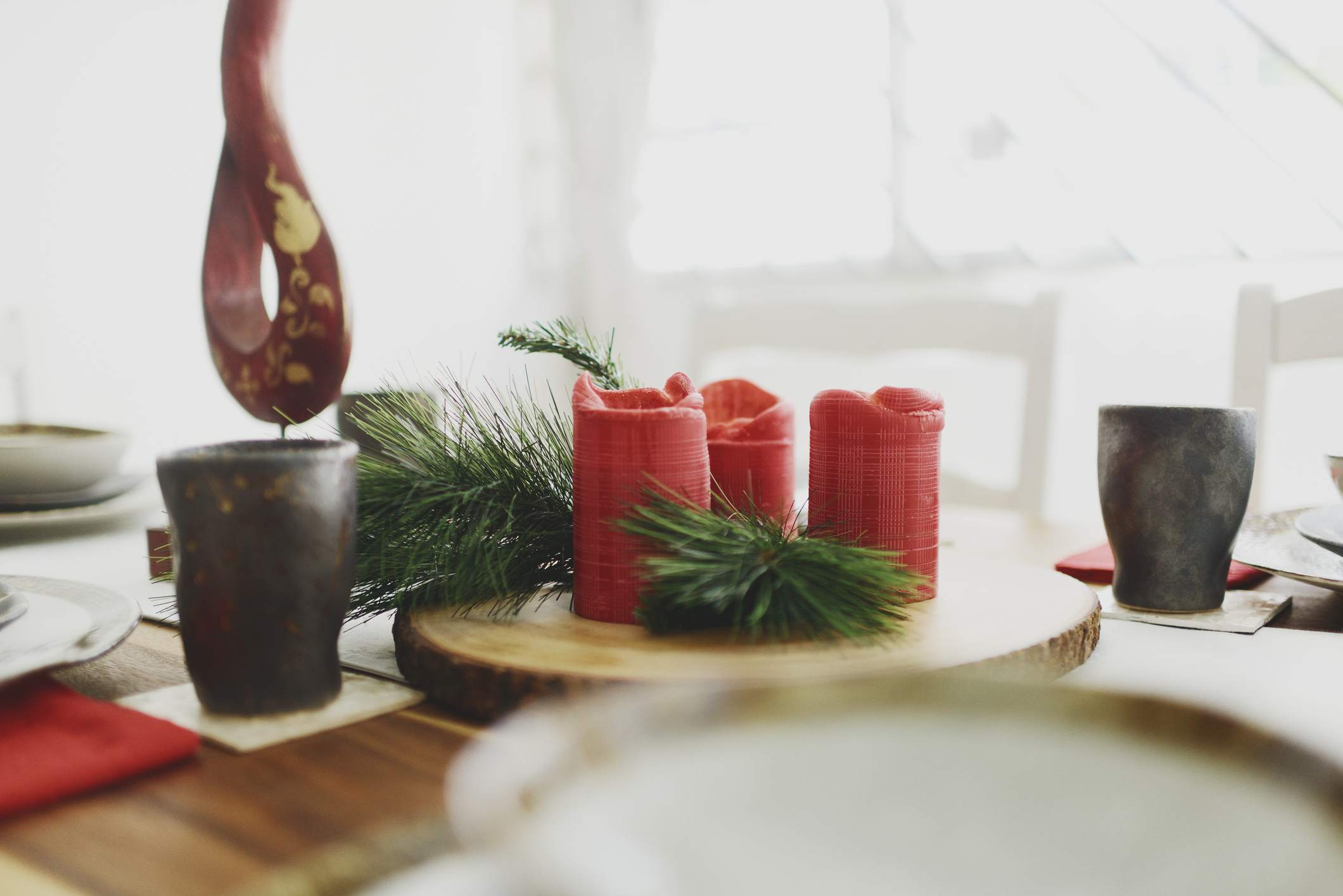 winter decor with red candles and evergreen branches