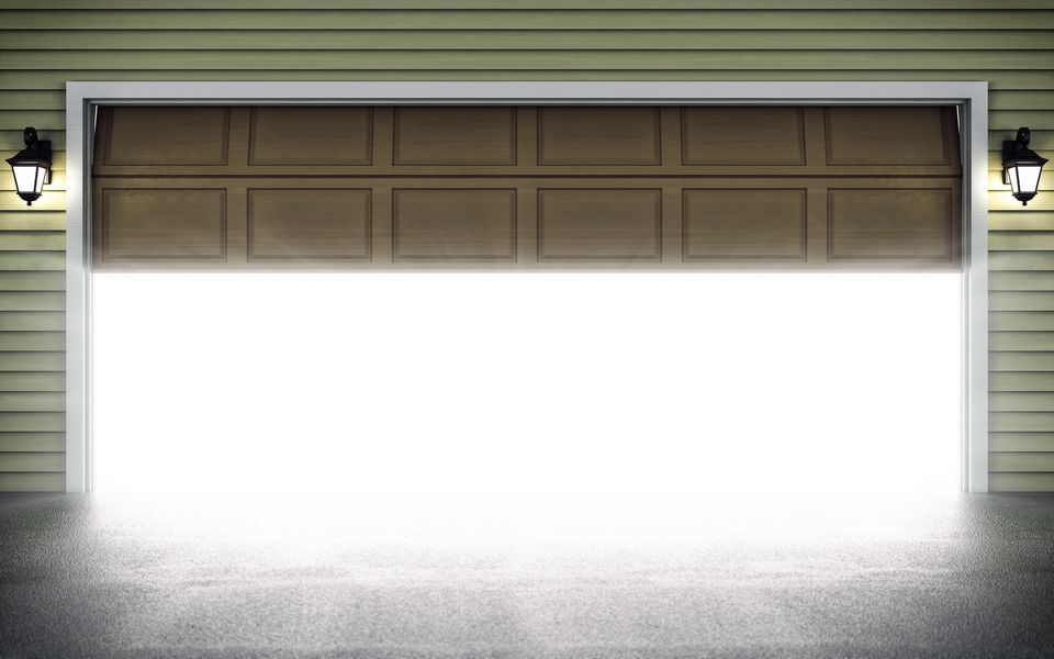 A half-open garage door full of light