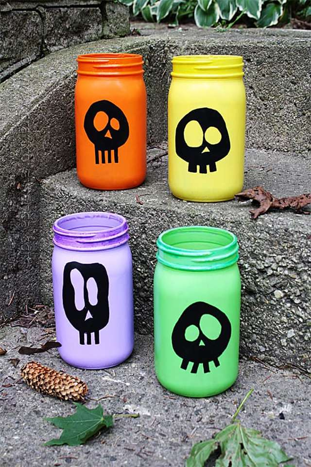 Colorful skull candles on a porch