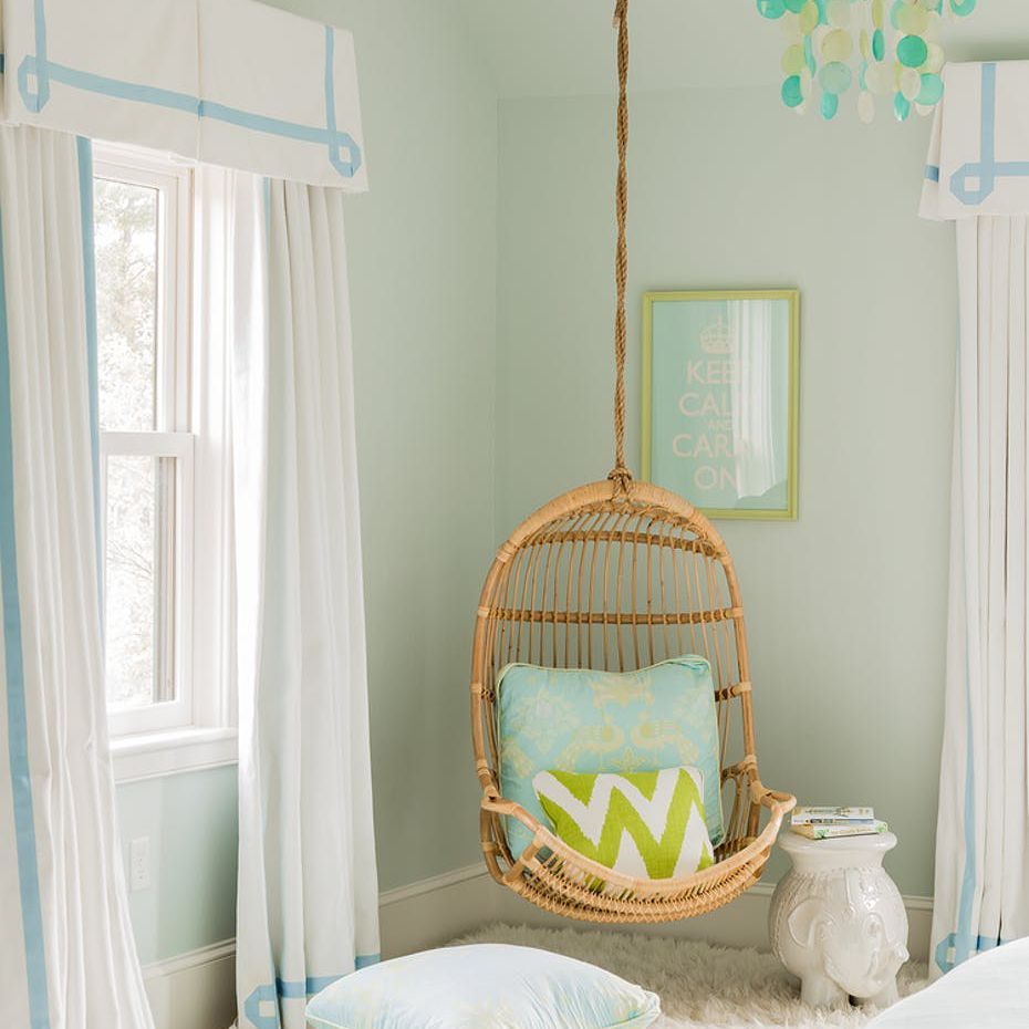 blue and green tween room with wicker swing