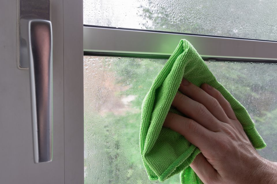 Cleaning window with microfiber cloth
