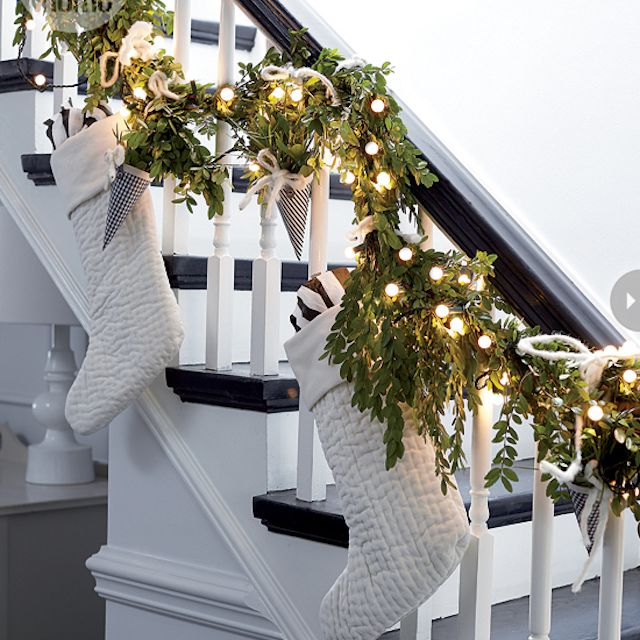 banister with white stockings - Railing Christmas Decorations