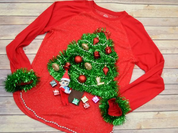 An ugly Christmas sweater with a Christmas tree on it