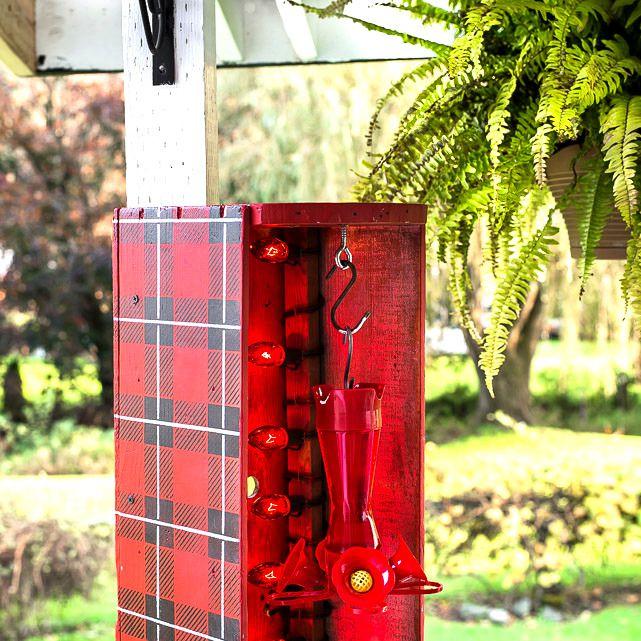 A red hummingbird feeder heater
