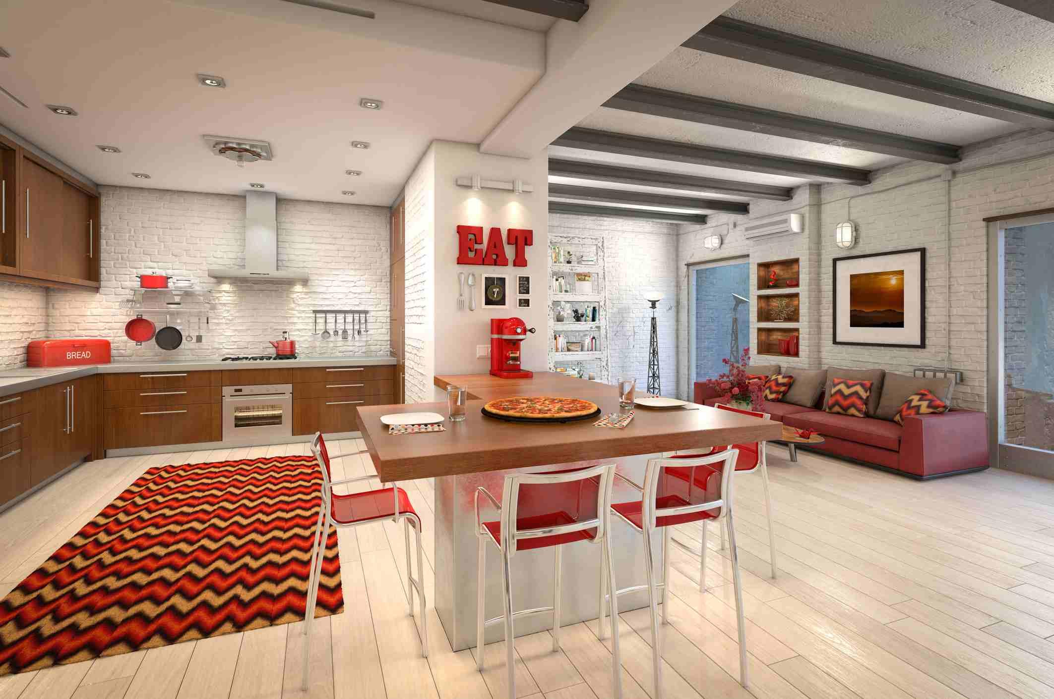 muebles y acentos rojos en toda la cocina abierta moderna del desván
