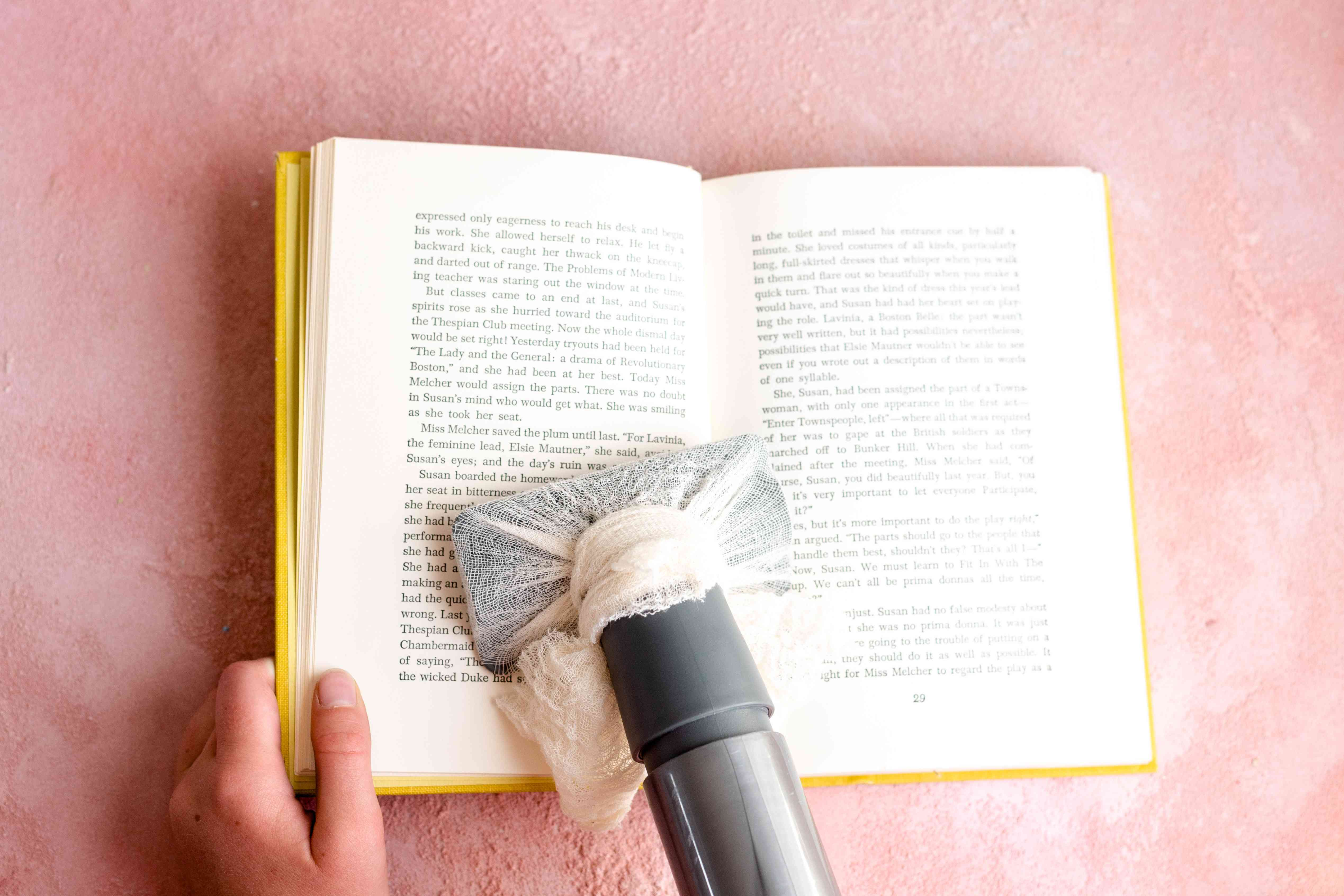 vacuuming inner pages of a book
