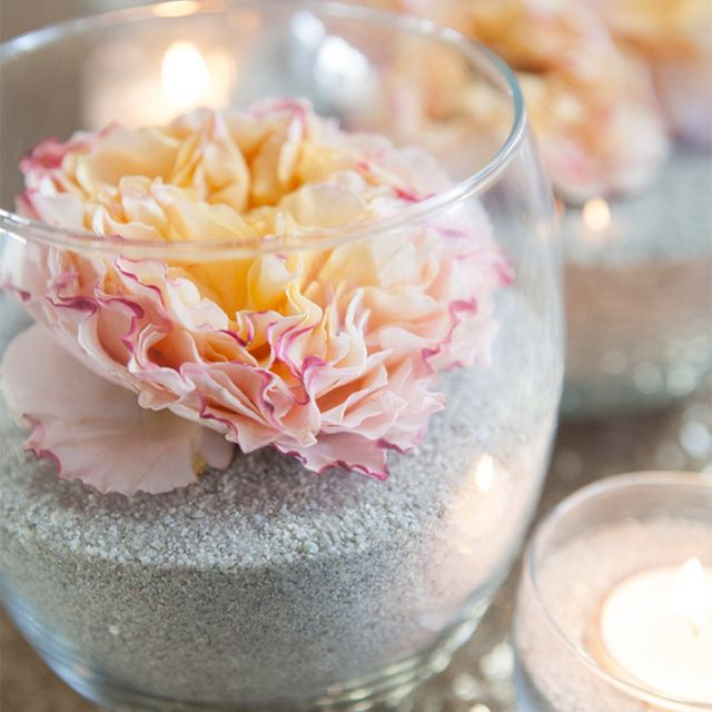 Sand and flower centerpieces