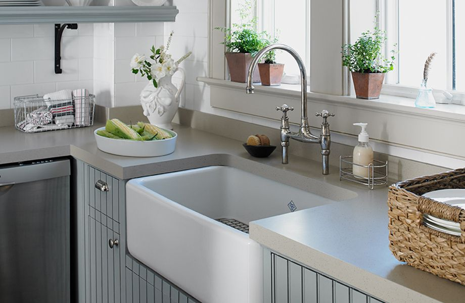 Thick gray solid surface countertop in bead board kitchen