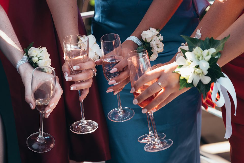 women with corsages toasting