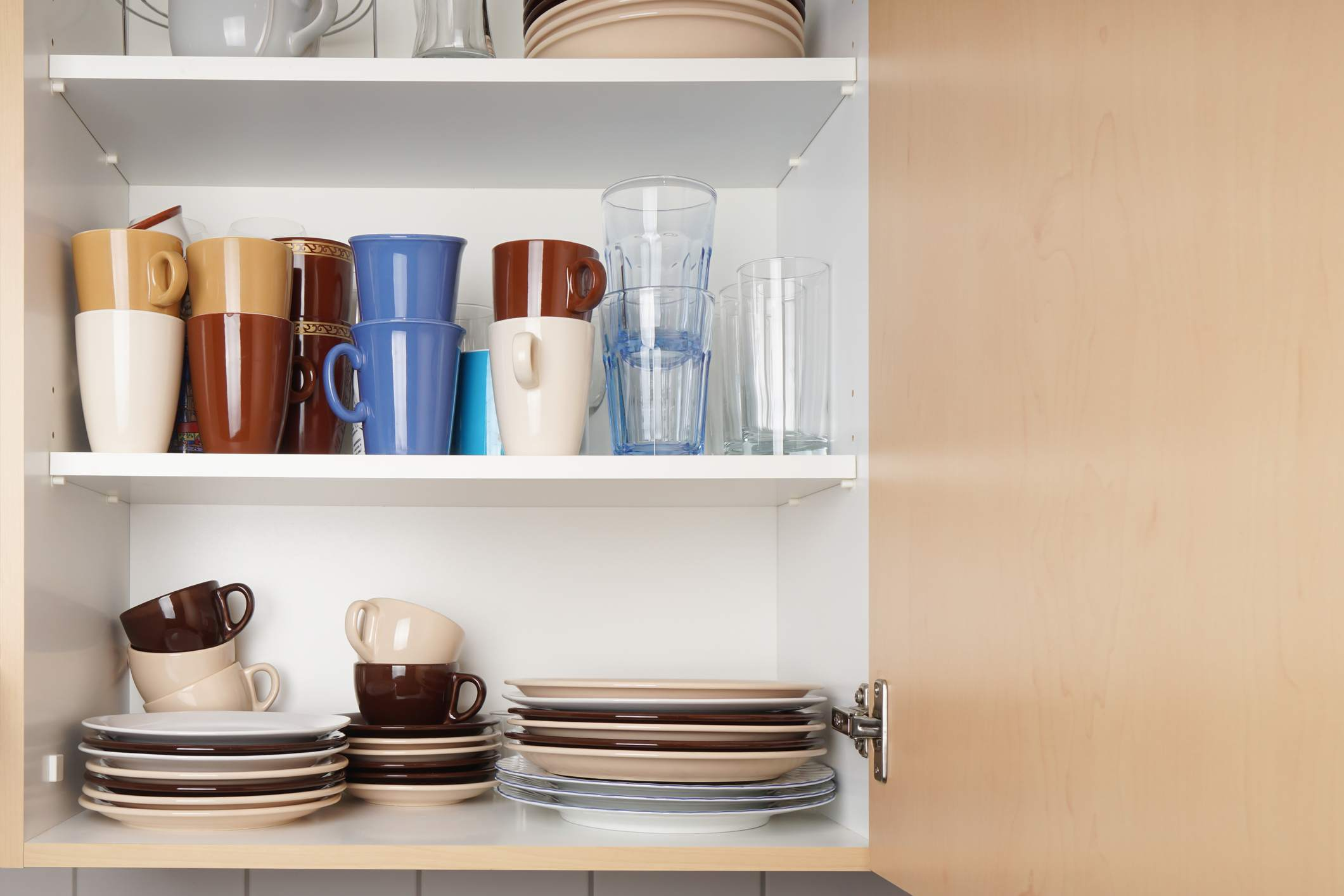 cabinet with glasses, mugs, and plates